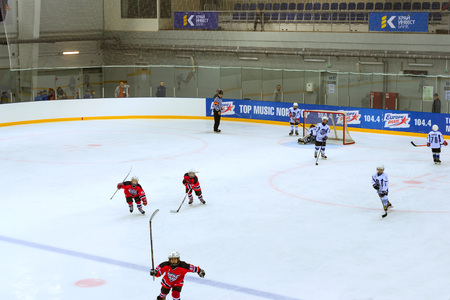 Adler, Russia - November 3, 2015: Friendly hockey tournament among childrens and teenage teams. Game on ice in Palace of winter sports Iceberg between teams of Angel of Siberia and Dmitrov. Adler, Sochi, Krasnodar Krai, Russia