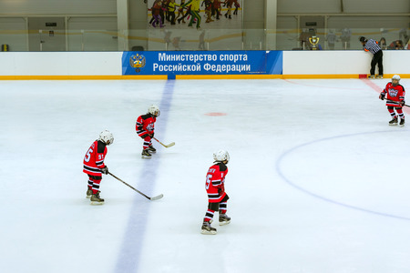 olympic national park: Adler, Russia - November 3, 2015: Friendly hockey tournament among childrens and teenage teams. Game on ice in Palace of winter sports Iceberg between teams of Angel of Siberia and Dmitrov. Adler, Sochi, Krasnodar Krai, Russia