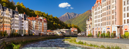 SOCHI, RUSSIA - OCTOBER 31, 2015: Rosa Khutor hotel buildings and infrastructure of Alpine ski resort. Constructed from 2003 to 2011. Krasnaya Polyana, Sochi, Krasnodarskiy kray, Russia. Multi-storey modern building on banks of Mzymta river Editorial