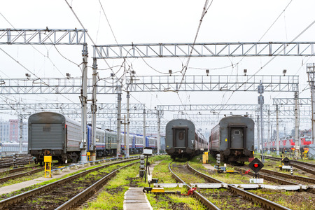 operational: Old locomotives and  railcars rzd stand on railroad tracks of technical railway station - operational locomotive depot. Transport infrastructure of Russian railways, St. Petersburg