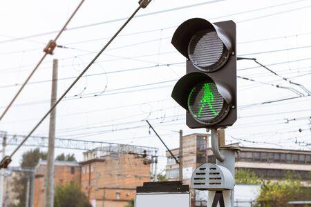 operational: Railway semaphore shines permissive green light. Technical railway station - operational locomotive depot. Transport infrastructure of Russian Railways, St. Petersburg Stock Photo