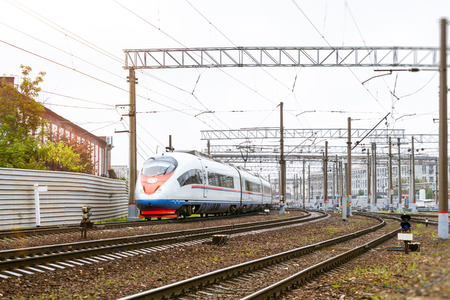 operational: Modern hybrid electric locomotive Sapsan pulling high-speed train with railcars rzd on rails. Technical railway depot. Transport route St. Petersburg - Moscow, Saint-Petersburg railway station, Russia Stock Photo
