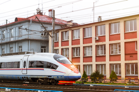 operational: Modern hybrid-electric locomotive Sapsan pulling a high-speed train on rails. Technical railway operational locomotive depot. Transport infrastructure of railways, route St.Petersburg - Moscow, Russia Stock Photo