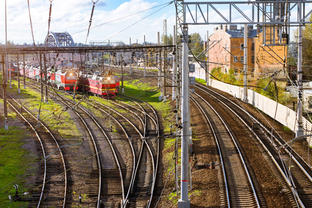 operational: Old locomotives rzd stand on railroad tracks of technical railway station - operational locomotive depot. Transport infrastructure of Russian Railways, Saint-Petersburg