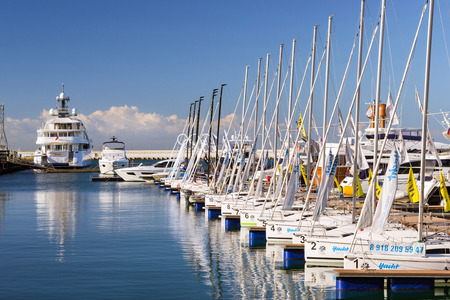 complex navigation: Sochi, Russia - November 1, 2015: Sailing yachts and private boats moored at pier in Sochi seaport. Grand Marina station complex Port. Krasnodarskiy kray, Russia Editorial