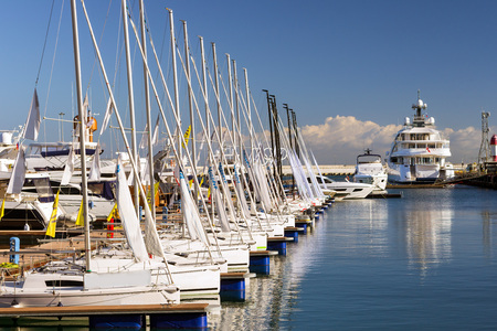 complex navigation: Sailing yachts and private boats moored at pier in Sochi seaport. Grand Marina station complex Port. Krasnodarskiy kray, Russia