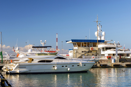Private boat and yachts moored at pier in Sochi seaport. Marine station complex Port. Krasnodarskiy kray, Russia Stock Photo