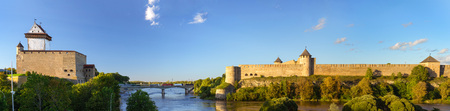 herman: Narva Herman castle and Ivangorod fortress stand on banks of Narva river. Medieval fortifications on Estonian-Russian state border. Hermanni linnus, Estonia, European Union, Russia Stock Photo