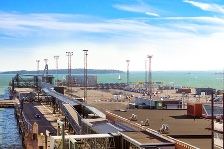 developed: Ferry cargo-passenger terminal West Harbour. Developed infrastructure of Scandinavian sea port with pedestrian moving walkways, bridges and car carrying system