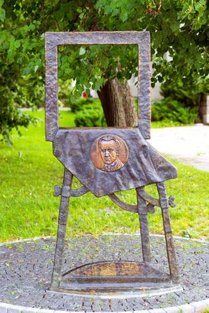 Vilnius, Lithuania - August 8, 2012: Bronze monument to Mstislav Valerianovich Dobuzhinsky in Cathedral Square. Dobuzhinsky 1875-1957 - Russian artist, master of urban landscape, art critic, memoirist Stock Photo