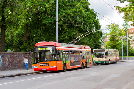 traction: Vilnius, Lithuania - August 8, 2012: Vilnius trolley rides along a busy street. City public electric transport environmentally friendly and economical way of organizing traffic in a major metropolis Editorial