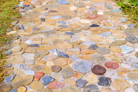 greece granite: Pedestrian path paved with granite stone. Texture of natural stone. Village Bali, Crete island, Greece