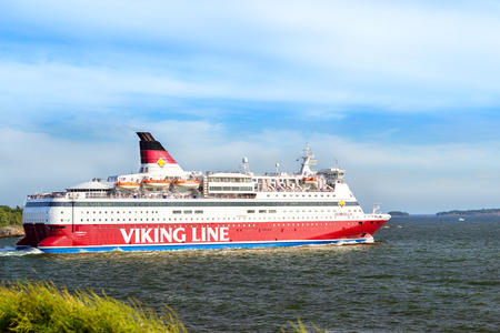 Helsinki, Finland - August 4, 2012: Cargo-passenger cruise ferry Viking Line - Gabriella goes from port Helsinki across Bay Kruunuvuorenselka near island Suomenlinna. Suomi, Helsingfors, South Gulf Editorial