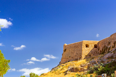 Fortezza Castle - Venetian fortress on hill Paleokastro in resort Rethymno. Greek architecture on coast of Kolpos Almirou. Leof. Emmanouil Kefalogianni, Crete, Greece