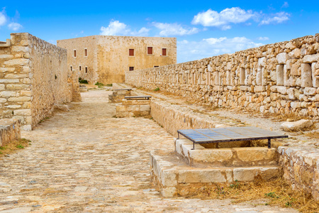 Inner courtyard & fortifications, surrounded by stone walls, Fortezza Castle - Venetian fortress with Bastion defense system on hill Paleokastro in resort Rethymno. Historical attractions Crete Greece Standard-Bild