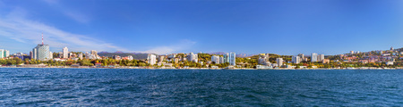 complex navigation: View from water during boat trip at architecture of modern resort town Sochi, hotels, sanatoriums, television tower. Krasnodarskiy kray, Russia