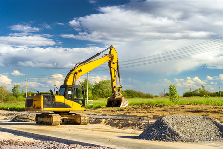 Crawler Excavator digging bucket on construction of high-speed bypass road around Krasnoe Selo, Saint Petersburg. Heavy machine equipment for excavation works at civil industrial construction. Russia