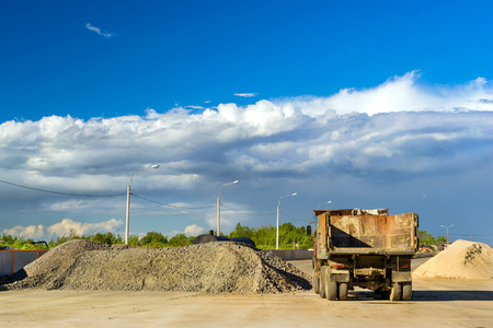 sand quarry: Heavy empty truck is waiting for loading of gravel. Construction of high-speed bypass road around Krasnoe Selo, Saint Petersburg. Heavy machine equipment for civil industrial construction. Russia