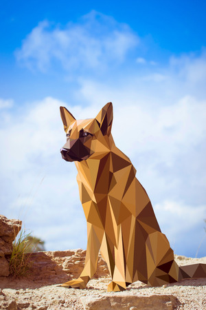 Guard dog German shepherd in polygons style, sitting on hind legs. Dog is symbol of New 2018 year, according to Chinese calendar Year Of Yellow Earth Dog. Pet and guard dog, loyal friend of man