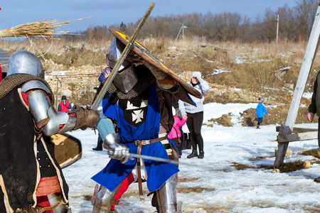St.Petersburg, Russia - March 13, 2016: Knight's tournament at festival of Maslenitsa. Shrovetide festivities, pancake week. Celebrate end of winter. Cosplay in knight's clothing with swords and armor