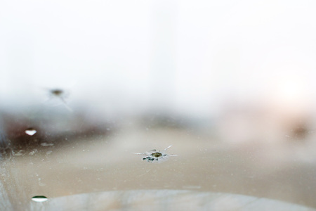 Broken car glass with crack on windshield of auto 스톡 콘텐츠