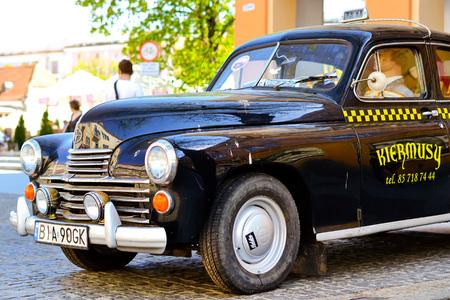Bialystok, Poland - April 30, 2012: Black retro car brand FSO, Polish company producing cars in Warsaw. First FSO car was Warszawa model, Polish version of Soviet GAZ M-20 Pobeda 1951-1973 Editorial