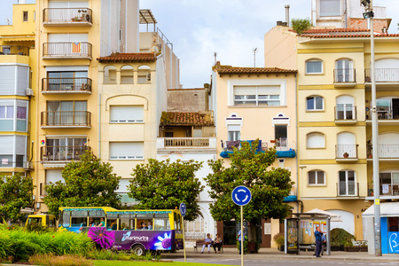 Blanes, Spain - 30 may, 2018: Architecture of Spanish beach resort Blanes in summertime. Costa Brava, Catalonia. Tourist bus to the Botanical garden Marimurtra stands at the bus stop