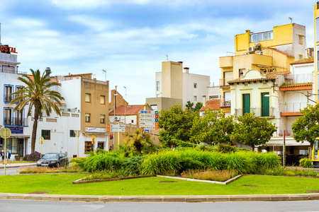 Blanes, Spain - 30 may, 2018: Architecture of Spanish beach resort Blanes in summertime. Costa Brava, Catalonia. Flower bed in the city square Editorial