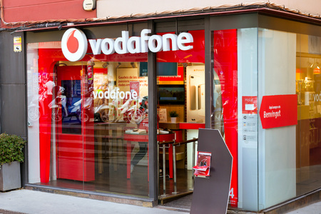 Blanes, Spain - 30 may, 2018: Signboard of telecommunications company Vodafone on glass wall of building in the city center. Spanish beach resort Blanes, Costa Brava, Catalonia
