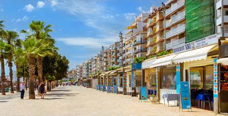 Blanes, Spain - 30 may, 2018: Pedestrian promenade with palm trees, cafes and restaurants. Architecture of Spanish beach resort Blanes in summertime. Costa Brava, Catalonia Editorial
