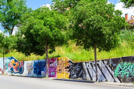 Blanes, Spain - 31 may, 2018: Modern street drawings graffiti on concrete slabs along the road. Actual street art and fine arts. Architecture of Spanish beach resort Blanes. Costa Brava, Catalonia Editorial
