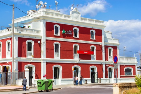 Blanes, Spain - 31 may, 2018: Main building of Blanes train station. Developed transport infrastructure in coastal resorts Spain. Architecture of Spanish beach resort in summer. Costa Brava, Catalonia