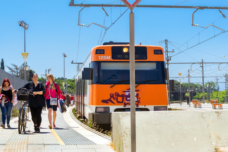 Blanes, Spain - 31 may, 2018: Intercity electric train, Blanes train station. Developed transport infrastructure in coastal resorts Spain. Costa Brava, Catalonia Editorial