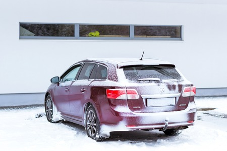 Narva-Joesuu, Estonia - 17, January 2017: Snow-covered Japanese car Toyota Avensis station wagon parked in Parking lot. Severe Northern winter and snowy weather. Resort town in Ida-Virumaa, Narva