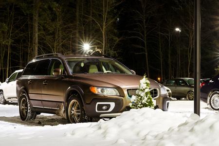 Narva-Joesuu, Estonia - 17, January 2017: Snow-covered Swedish car brand Volvo XC60 station wagon parked in Parking lot. Severe Northern winter and snowy weather. Resort town in Ida-Virumaa, Narva Editorial