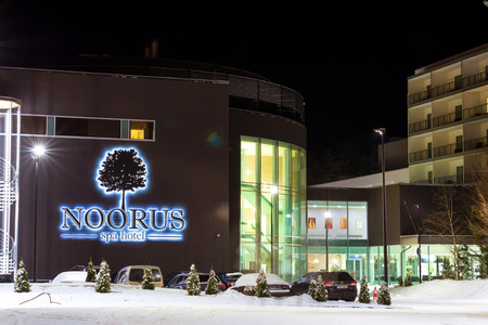 Narva-Joesuu, Estonia - 17, January 2017: Modern building Noorus SPA Hotel made of glass and concrete amidst a snowy winter landscape at night. Narva-Joesuu resort town in Estonia in Ida-Virumaa