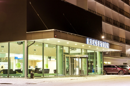 Narva-Joesuu, Estonia - 17, January 2017: Modern building Noorus SPA Hotel made of glass and concrete amidst a snowy winter landscape at night. Narva-Joesuu resort town in Estonia in Ida-Virumaa