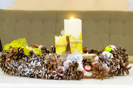 Christmas new year interior with pine cones and candles. Festive winter decorations. Narva-Joesuu, Estonia, Ida-Virumaa