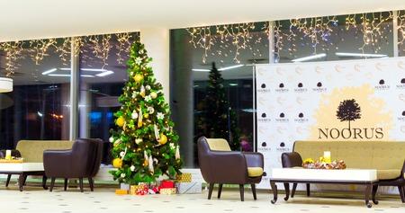 Narva-Joesuu, Estonia - 17, January 2017: Christmas and new year interior of resort Noorus SPA Hotel, modern building made of glass and concrete. Festive winter decorations. Estonia, Ida-Virumaa Editorial