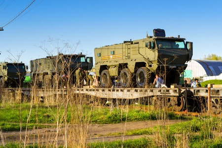St.Petersburg, Russia - may 10, 2018: Modern Russian military armored car Typhoon-K, installed on transport railway platform for transportation to place of military exercises. Army equipment, weapons