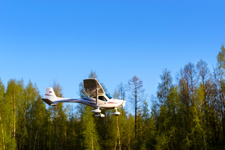 Light passenger plane lands at a private airport, Kronshtadt, St. Petersburg, Russia. Professional flights on airplanes. Industrial and civil air transportation by aircraft