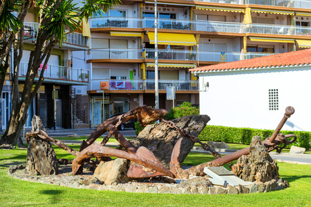 Blanes, Spain - 31 may, 2018: Monument with anchors to the sailors. Historical monument, sculptural composition. Architecture of Spanish beach resort Blanes in summertime. Costa Brava, Catalonia Editorial