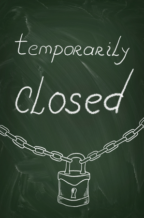 green sign: Temporarily closed caption written on a blackboard with chalk