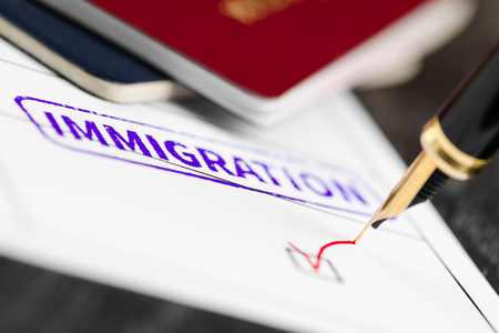 Application form close up approved, fountain pen and immigration stamped on a document. Stock Photo