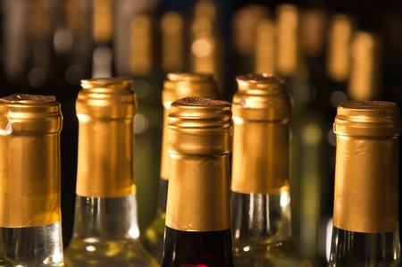 Closeup of full & corked bottles of wine