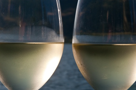 Closeup abstract of two glasses of white wine with condensation on the outside of them Banco de Imagens
