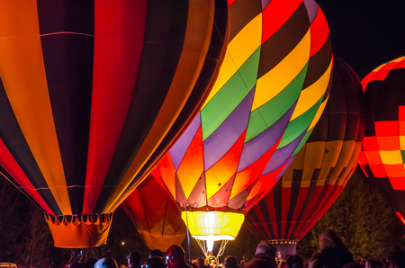 Bright Hot Air Balloons Glowing at Night photo