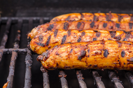 Sausage covered in sauce on grill Banco de Imagens - 31025781