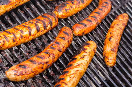 Sausage covered in sauce on grill Banco de Imagens - 31025783