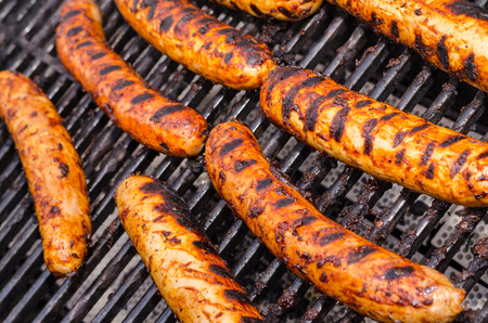 Sausage covered in sauce on grill Banco de Imagens - 31025784